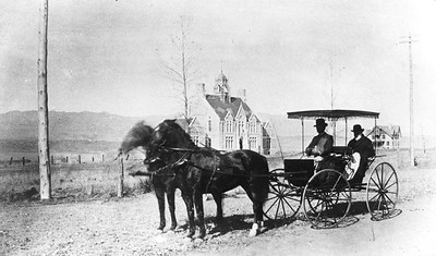 President Tenney, in rear seat of carriage, surveys campus in 1883