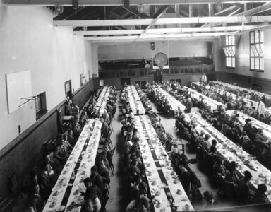 Homecoming dinner - The men�s gym was used as a Dining Hall prior to the 1950s, when coed dining commenced in Taylor Hall